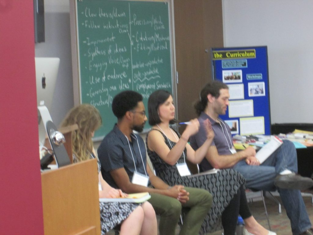 Four teaching assistants from writing-intensive courses--Kayci Harris from History, Harvey Long from the Information School, Angela Serrano from Sociology, and Micah Kloppenberg from Biology--participate in a panel discussion as part of WAC training for c. 70 new writing-intensive TAs from across UW-Madison on August 27 and 28, 2018.