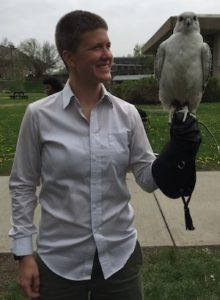 Katie Lynch, holding a hawk