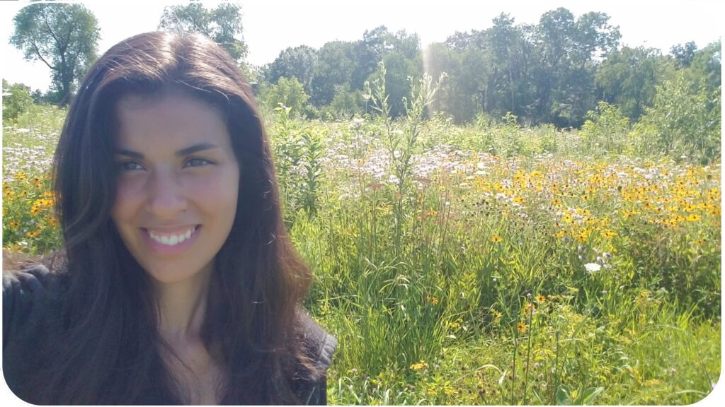 Mia with field of wildflowers