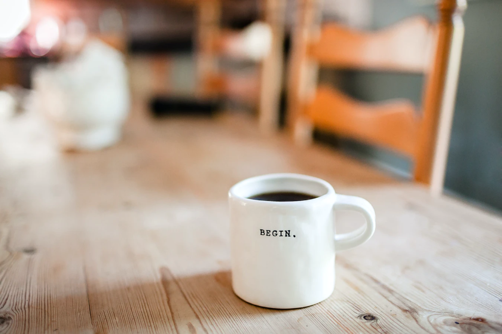 A coffee cup with the word