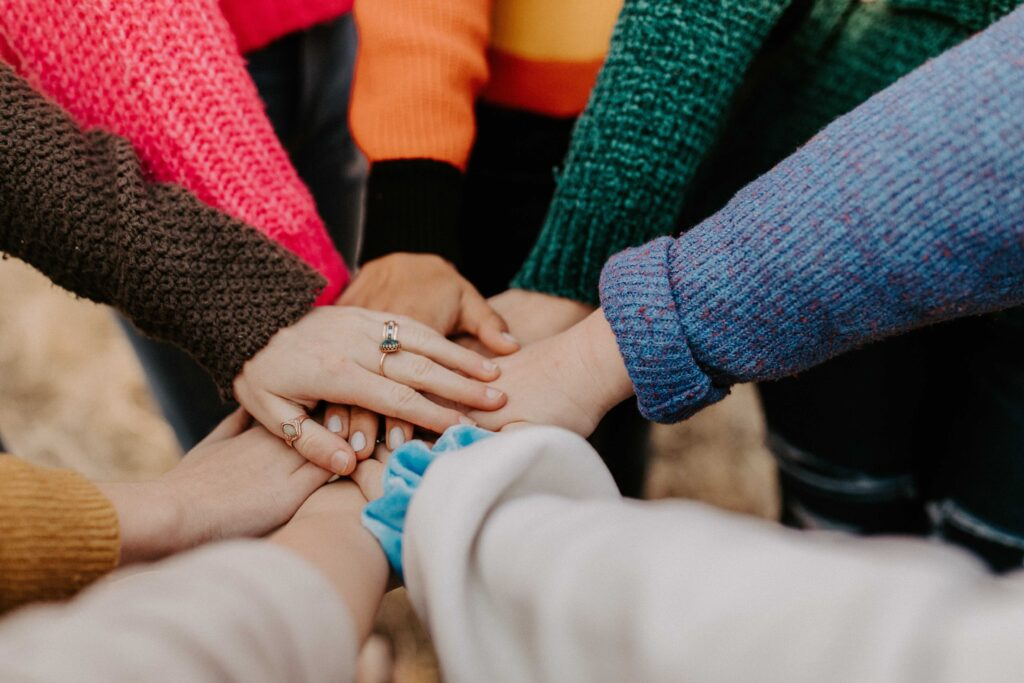 Hand meet together in a sign of teamwork.