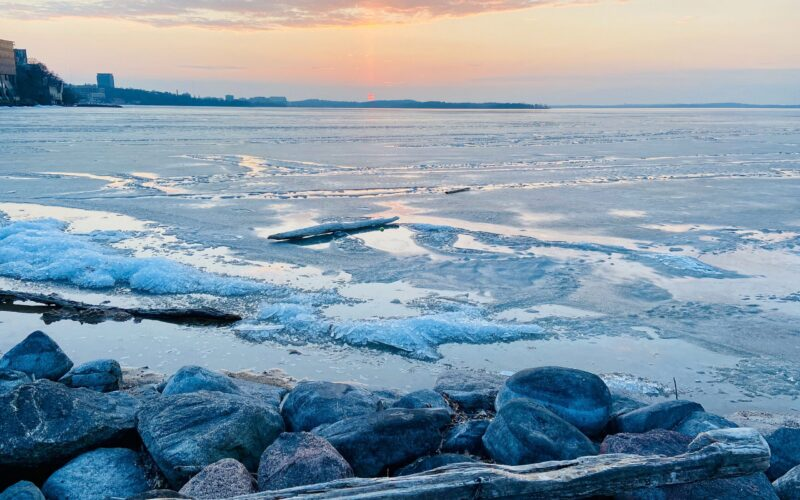 images shows the ice breaking and piling up on Lake Mendota