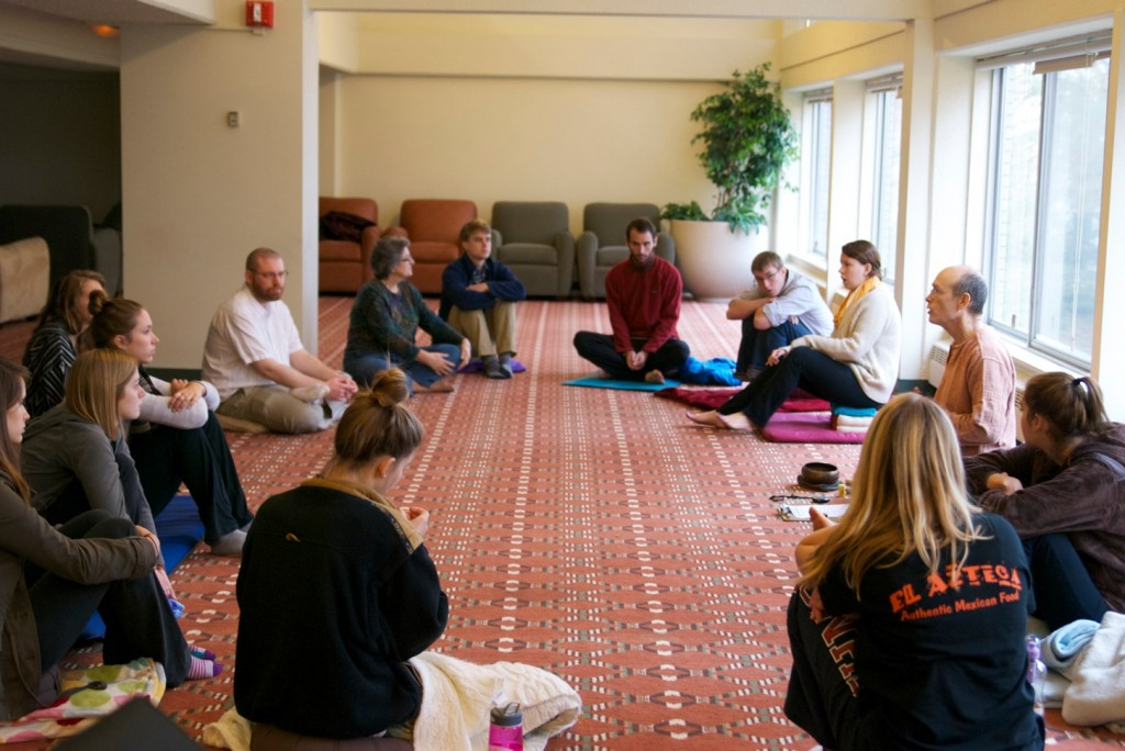 "Students in ""Love and Attachment in Buddhist Art and Literature"" learn meditation techniques."