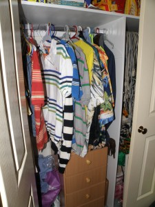 "Deciding what clothes to wear can also be a challenge. ""Closet 2009 Australia"" by Matthew Paul Argall is licensed under PD-Self"