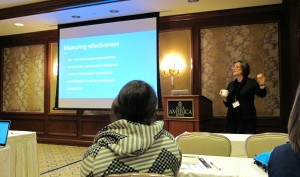 "Christine Modey gives her NCPTW presentation on ""Mini-Courses to Develop Tutors' Expertise."""