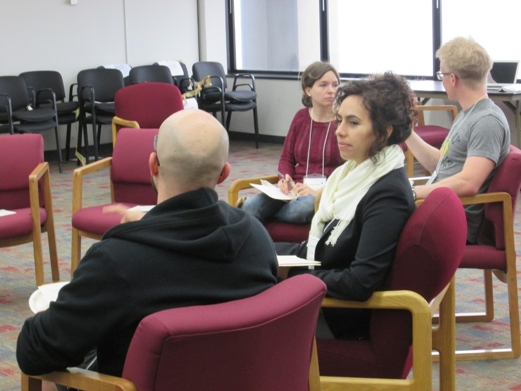 Some of the participants in one of the spring 2015 grad writing groups share goals at the start of their weekly three-hour writing session.