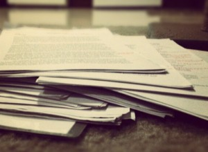 An overflowing stack of student papers.