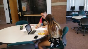 Jonathan, one of seven undergraduate peer writing tutors, collaborating with a student writer in the Writing Center.