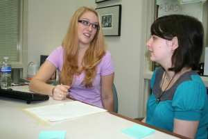 Student-tutor Valerie Bastian works with a student on a new assignment.