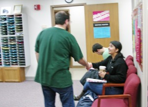 Greeting a student in the Writing Center's waiting area.