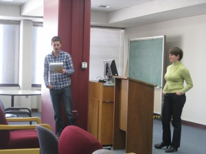 Chris Earle moderates a talk given by Carla Oppenheimer on sharing expertise in conferences.