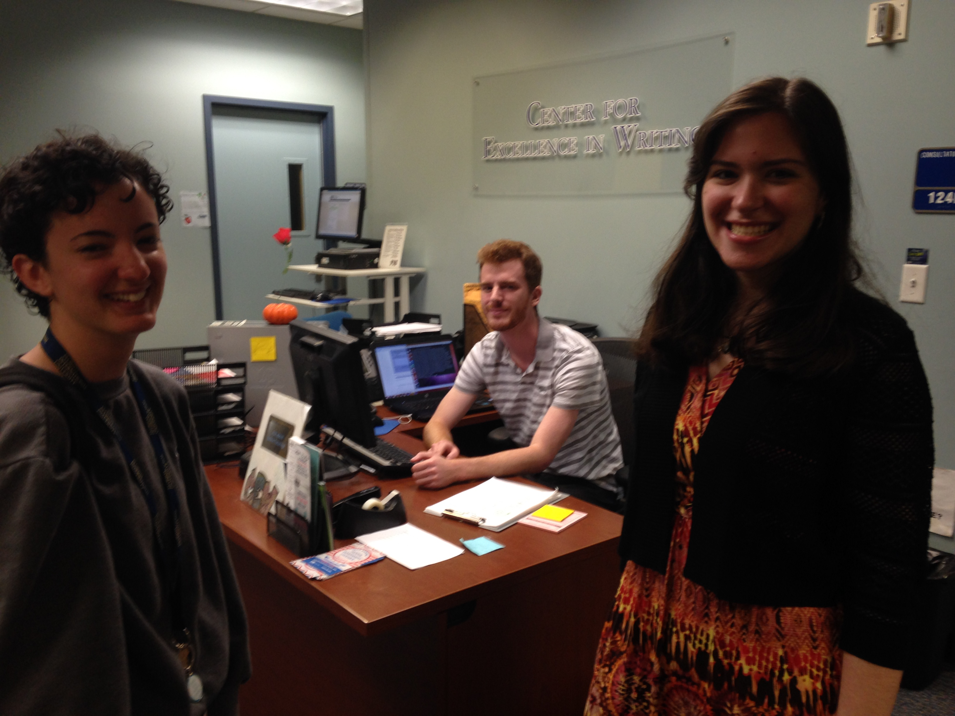 Madai, now a student and future tutor at the Florida International University writing center, visits our receptionist, Stephen, and tutor, Gisela.