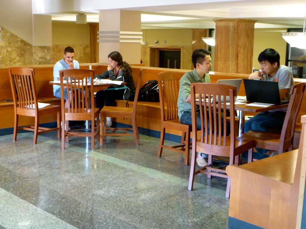 Sophomores Alex Daneshgar and Leah Steinmetz study organic chemistry, while journalism graduate students Leo Shan and Yuhai Chen work on statistics, a few hours before the Writing Center sets up shop in Memorial LIbrary.