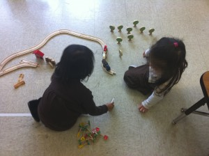 - These children are engaged in free play, while at the same time practicing social skills, spatial skills, fine motor skills, sorting skills, and storytelling skills.