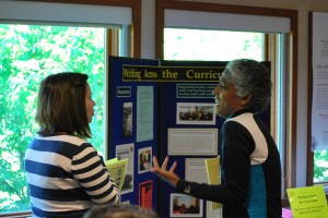 WAC Assistant Director Elisabeth Miller chatting with a faculty member from the School of Nursing at the Teaching Academy Summer Institute at the Arboretum, June 2014